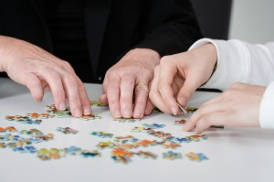 Picture of people making a puzzle